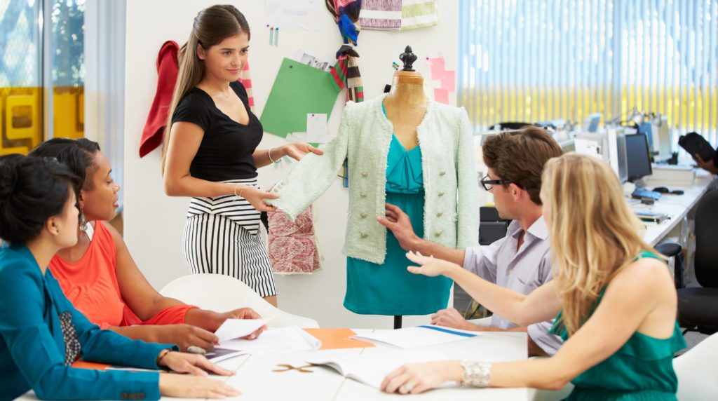 Meeting in fashion design studio discussing ideas for Work from home fashion design jobs