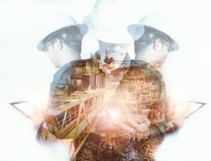 Double exposure of Marine Engineer or Technician man with safety helmet operated platform or plant by using tablet with offshore oil and gas platform background for oil and gas business concept